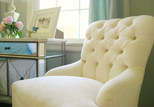 Tufted and mirrored furniture